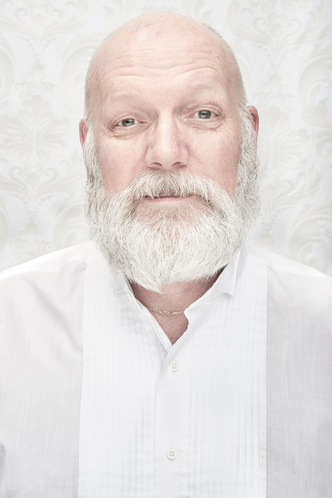 White on white portrait of man with beard
